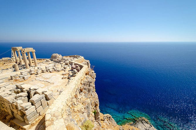 Day-5—View-on-Acropolis-in-Lindos,-Rhodes-island,-Dodecanese,-Greece—iStock-1050267284