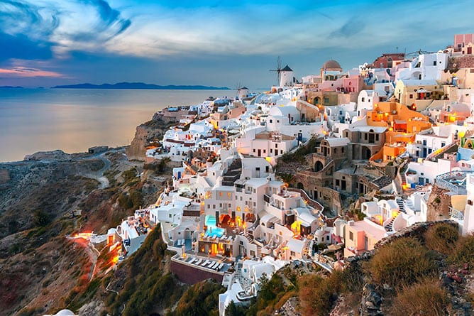 Day-6—Oia-at-sunset,-Santorini,-Greece—iStock-531306396