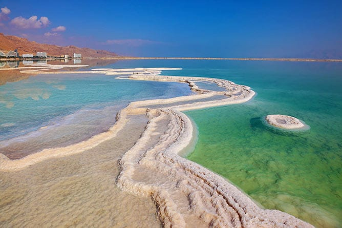 Day-8—Dead-Sea-Hotels-are-reflected-in-water—iStock-521870299